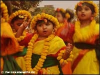Young girls in Shantinkatan, WB celebrating Holi